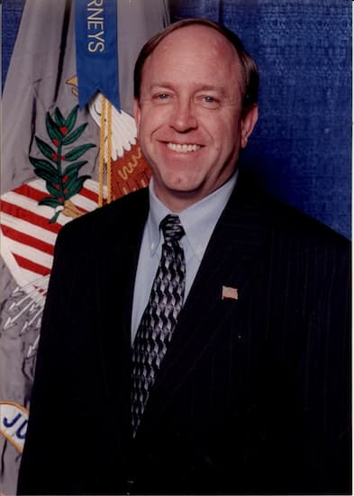 A photo of John Suthers